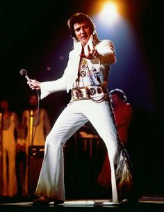 Elvis Live On Stage: June 2 1975 (8:30 pm). Mobile AL. Municipal Auditorium. This Iconic Photo was shot by Ed Bonja and used for the cover of the From Elvis Presley Boulevard Memphis, Tennessee Lp in 1976.