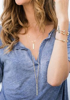 If you've been on the hunt for a cute double-chain necklace, then put the search to an end with this golden chained necklace. It has metallic pendants with lobster clasp closure. This necklace is perfect for adding pretty, feminine charm to any of your outfits.