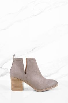 Get stepping in this taupe cut out ankle bootie. Featuring a side cutouts.