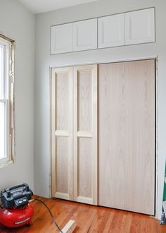 How We Added Extra Hunky Trim to Our Bi-Fold Doors Adding decorative trim to bi-fold doors to turn them into something more custom is nothing new (we used inspiration from Room for Tuesday and DIY Playbook, and Project Palermo recently turned her doors in Closet Door Makeover, Sliding Closet Doors, Wardrobe Doors, Custom Bifold Closet Doors, Black Wardrobe, Home Renovation, Home Remodeling, Closet Bedroom, Closet Paint