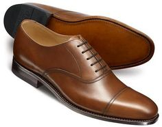 $199, Brown Leather Oxford Shoes: Charles Tyrwhitt Brown Carlton Toe Cap Oxford Shoes. Sold by Charles Tyrwhitt. Click for more info: http://lookastic.com/men/shop_items/148041/redirect