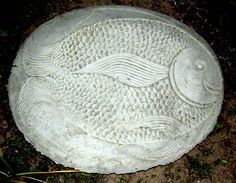 Made with quikrete cement with a plastic thrift store tray as a mold. This made a large fishy stepping stone for my garden. Cost? $3.00.