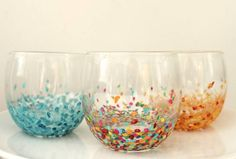 13.) These confetti tumbler glasses were inspired by a pricey glassware set, but cost only $2 to make.
