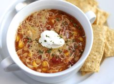 Chicken Chili - delicious with cheddar, onion and avocado slices (forgot a dash of soy sauce)