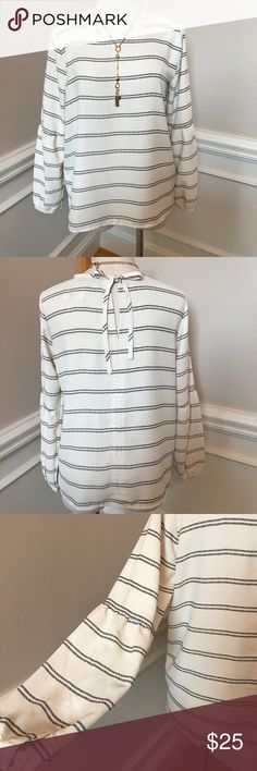 """Ann Taylor Loft Bell Sleeve Dress Top -Sz M Comfortable off-white with black stripes tie- closure, long-sleeved dressy Top by Ann Taylor Loft. Size M is 20"""" across bust and 24"""" from collar to bottom of hem. Sleeve is approx 24"""" long. Bell part of Sleeve starts at approx 12"""" down. Loft by Ann Taylor Tops Blouses"""