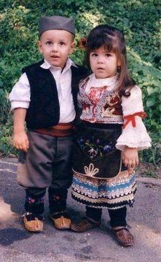 Serbian children wearing traditional folk clothing.