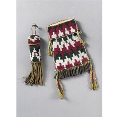 A MESCALERO APACHE BEADED AND FRINGED HIDE STRIKE -A-LITE AND WHETSTONE CASE