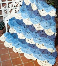 This Lacy Shell Afghan is light, lovely, and lusciously soft. In pretty shades of blue, this free afghan  crochet pattern is fun and flirty.
