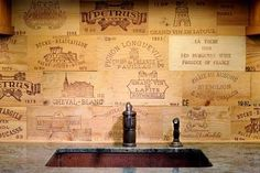 """Wine crates cut into """"tile"""" & used as a backsplash...this would be awesome for a basement with a bar."""