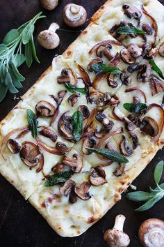 Mushroom Fontina Flatbread with Crispy Sage Recipe on twopeasandtheirpod.com This quick and easy flatbread is great served as an appetizer or meal!