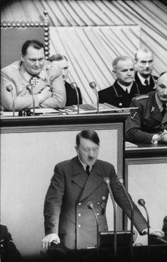 Adolf Hitler speaking to the Reichstag with Göring behind him, c.1941