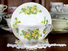 Queen Anne Tea Cup and Saucer, Beautiful Footed Cup, English Bone China, Yellow Florals on a White background. Cup measures inches high and inches out to handle. The saucer i Tea Cup Set, My Cup Of Tea, Tea Cup Saucer, Vintage China, Vintage Tea, Yellow Tea Cups, Tea Riffic, China Cups And Saucers, Chocolate Cups