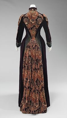 Dress (back view) Mme. Uoll Gross Date: 1888 Culture: American Medium: silk, metal Accession Number: 2009.300.618a, b