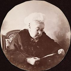 c1890. Photograph of Queen Victoria wearing spectacles and leaning forward to read a piece of paper that she holds in both hands. Towards the end of Queen Victoria's life the portraits issued showed her just as she was: an elderly lady. It seems as though, throughout her life, the Queen wished to show her feelings to the world: first as a wife; then as a broken-hearted widow; and finally as the Queen Empress who was the 'grandmother of Europe' and mother of her people.