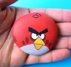 Hand Painted angry bird stone ! A gift idea for your kids, handmade painted stone made by me! Is painted on a smooth sea stone which i have