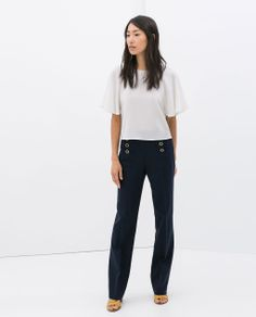 Image 1 of TROUSERS WITH FRONT BUTTONS from Zara