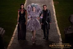 Effie Trinket, Katniss and Peeta in The Hunger Games: Catching Fire