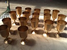 Home Made Trophies for Party Favours at a boys Hot Wheels party $3 plastic wine glasses from the Reject Shop plus $4 Fiddly Bits gold spray paint from Bunnings equals $7 WIN