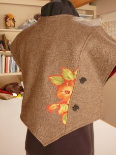 Another view showing the cute buttons.  Not sure why she made buttonholes, though.  :)