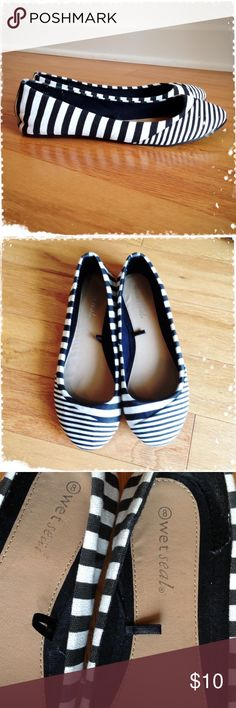 Wet Seal black & white striped flats In like new condition!   Soles are a little dirty but otherwise, the shoes are in excellent condition!!   PLEASE NOTE:   Label says size 8 but they are more like a 6 - 6 1/2!!! Wet Seal Shoes Flats & Loafers