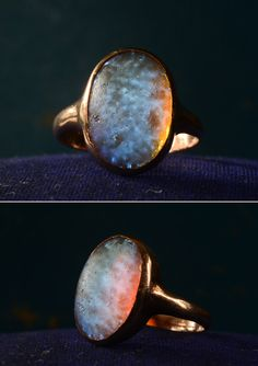 'This is probably the earliest dragon's breath opal ring I've ever found, and it's extremely rare to find one mounted in gold.  Dragon's breath is a rare man-made art glass that sort of looks like a combination of an opal and moonstone, but more psychedelic.  There are a number of crazy, mystical looking glass stones from the turn of the century, inspired by Art Nouveau aesthetics.' - Erie basin