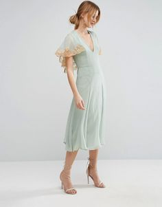 A beautiful lace trimmed chiffon cape dress from ASOS. In mint green chiffon with a lace trimmed cape and backless cut. Perfect for weddings and parties