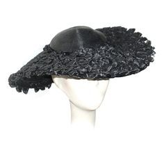 Oversized saucer hat, 1940's | Label: Adrienne Fifth Avenue New York | Materials: black straw with velvet trim