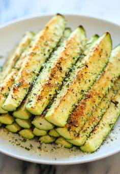 Baked Parmesan Zucchini - Crisp, tender zucchini sticks oven-roasted to perfection. Its healthy, nutritious and completely addictive!<br> Crisp, tender zucchini sticks oven-roasted to perfection. It's healthy, nutritious and completely addictive! Side Dish Recipes, Healthy Dinner Recipes, Low Carb Recipes, Healthy Snacks, Cooking Recipes, Diet Recipes, Side Dishes, Cooking Bacon, Vegetarian Recipes
