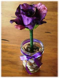 Good little gift, easy to make.  You can get everything at Michaels. Wrap green tape around the pen, put a fake flower on top, stick in a jar with pebbles.  Make a few to create a bouqet of flowers.  Great for your desk, kitchen, parlor.  You will never have to go looking through your pocket book or drawers for a pen!