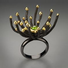 Ring | G.Kabirski.  Sterling silver with black rhodoum plating, gold and chrysolite.