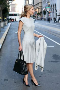 spring work outfits - 30 Spring Work Outfits To Try Right Now: Fashion Blogger 'Memorandum' wearing a light grey short sleeve drop waist pleated midi dress, a light grey blazer, black pointy toe heels and a black handbag