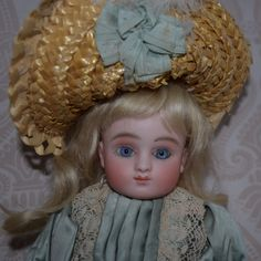 French Bisque Series C Steiner Doll with Trunk and Wardrobe