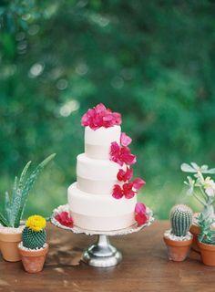 Wedding cake with Bougainvillea flowers.