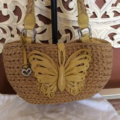 """Brighton purse Leather Butterfly & straw handbag, 9"""""""" tall 13"""" wide. Purchase this used, it is in great condition, no damage or stains, silver does have some tarnish. Inside is roomie, has 3 pockets for cell phone and other necessities and the key clip. Comes with the sleeper bag but no box Brighton Bags"""
