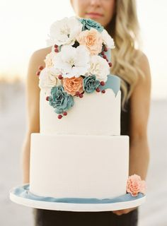 White wedding cake with peach and turquoise blue flowers | See more: http://mysweetengagement.com/15-extraordinary-wedding-cakes-for-all-wedding-styles