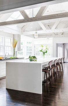 All White Kitchen with High Ceiling and Beams | www.thefoxandshe.com