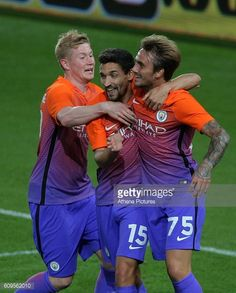 Aleix Garcia of Manchester City celebrates his goal with team mates Jesus Navas and Kevin De Bruyne during the EFL Cup Third Round match between...