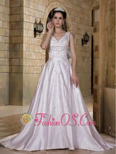 Luxurious A-line V-neck Wedding Dress Chapel Train Taffeta Beading    http://www.facebook.com/quinceaneradress.fashionos.us  www.fashionos.com   It is designed with an deep V-neckline which shows you sexy. The straps is encrusted with elaborate embroidery which continues throughout the bodice. This wedding dress is comfortable and gorgeous.