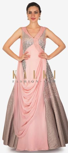 Buy Online from the link below. We ship worldwide (Free Shipping over US$100)  Click Anywhere to Tag Rose Pink Textured Satin and Georgette Sequined Gown with Drape Only on Kalki This rose pink textured satin and georgette gown offers a sparkling style, thanks to the sequined look.The pleated detailing on the neckline and bodice, the elegant drape at the front and the back focus style complete the look.