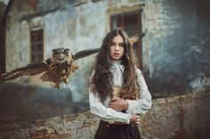 Laura and old mill... Victorian woman with flying owl and books - historical photos inspirated by poem old man, when live all his live in old mill from 12 century. You can see in background