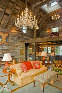 Rustic country home- love the chandelier