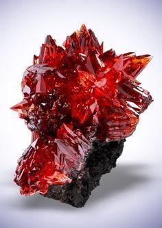 Rhodochrosite - N`Chwaning Mines, Kuruman, Kalahari manganese field, Northern Cape Province, South Africa  Watch this specimen sparkle on video here, it's gorgeous!!