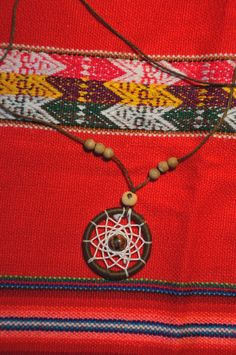 Dreamcatcher necklace with beads of bone.
