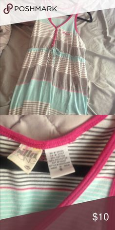 A striped dress from billabong It is tight on the top and has buttons on the top. Only worn once Billabong Dresses