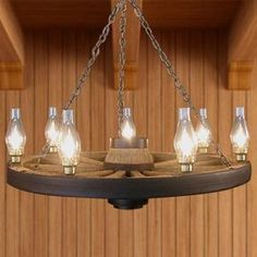 The Wagon Wheel Chandelier with Hurricane Lamps is an opulent display of old world design and rugged Western styling.