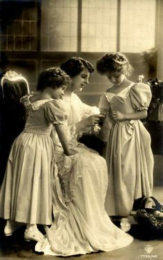 Edwardian mother teaching daughters to knit.