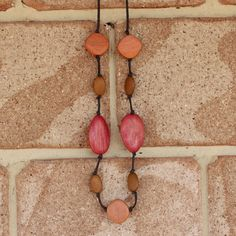 Stylish wooden jewellery inspired by my love of nature and the earthy colours of our beautiful planet. Handmade leather cord necklace featuring pink beads, orange beads and ochre beads. A beautiful rustic style which is suitable to be worn day or night.