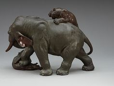 A large Japanese bronze sculpture of an elephant attacked by tigers, with seal mark, Meiji, circa - Bukowskis Hindu Statues, Bukowski, Bronze Sculpture, Seal, Sculptures, Elephant, Japanese, Tigers, Crafts