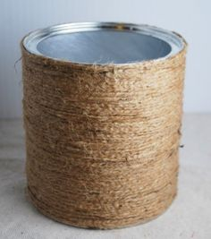 Wrap a coffee/formula can in rope/burlap/twine for a rustic look -to hold table stuff?