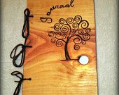 http://www.etsy.com/listing/92110063/tree-journal-notebook-wood-burnt-ready